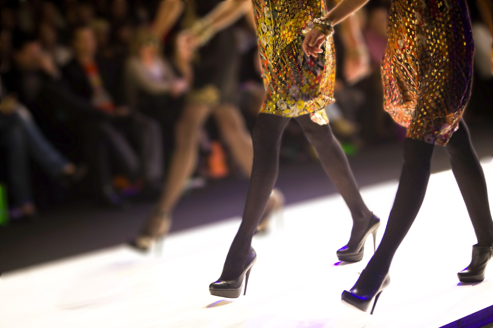 Runway with designer shoes and boots